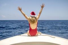 Femme appréciant Noël dans les Caraïbe Image libre de droits