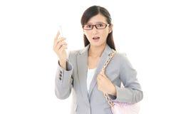 Femme asiatique étonnée d'affaires Image stock