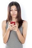 Femme asiatique avec le téléphone portable Photo libre de droits