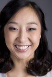 Femme asiatique d'affaires dans la tête de procès Photographie stock libre de droits