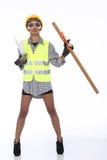 Femme asiatique d'Engineer d'architecte dans le casque antichoc jaune, sécurité vaste Photo libre de droits