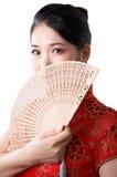Femme asiatique en rouge chinois Photographie stock libre de droits