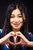 Femme asiatique exprimant des émotions en studio Photos libres de droits