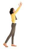 Femme asiatique poussant quelque chose Image stock