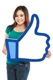 Femme asiatique se tenant comme le signe Image stock