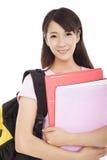 Femme assez asiatique de jeunes avec des livres photo libre de droits