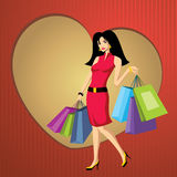 Femme assez jeune avec des sacs Image stock