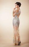 Femme assez songeuse dans la robe de soirée Photos libres de droits