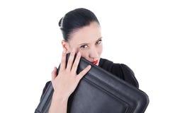 Femme attirant avec le cas en cuir Images stock