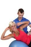 Femme attirant avec son entraîneur de forme physique Image libre de droits