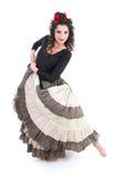Femme attirant dans la longue danse de jupe Photo stock