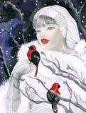 Femme attirant en forêt de l'hiver Photos stock