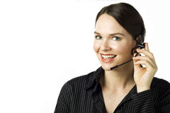 Femme attirante avec l'écouteur d'isolement au-dessus du blanc Image libre de droits