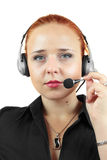 Femme attirante avec l'écouteur sur le fond blanc Image libre de droits