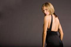 Femme attirante dans la robe photo stock