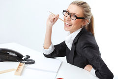 Femme au bureau Photographie stock