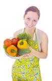 Femme au foyer avec des légumes photos libres de droits