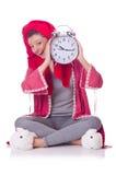 Femme au foyer avec l'horloge Image stock
