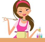 Femme au foyer-cuisson Image stock