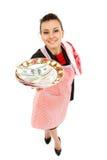 Femme au foyer de femme d'affaires avec de l'argent de la plaque Photos libres de droits
