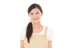 Femme au foyer de sourire Photo libre de droits