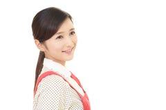 Femme au foyer de sourire Photographie stock libre de droits