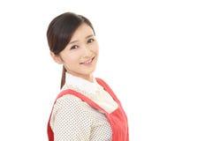 Femme au foyer de sourire Photographie stock