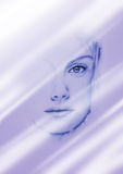 Femme au miroir Image stock