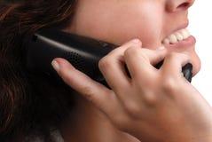 Femme au téléphone. D'isolement sur le blanc Images libres de droits