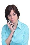 Femme au téléphone d'isolement sur le blanc Image stock
