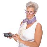 Femme avec à télécommande Photographie stock libre de droits