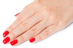 Femme avec de beaux ongles rouges manicured Images stock