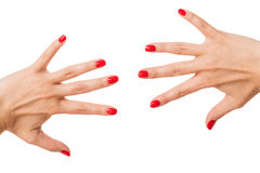 Femme avec de beaux ongles rouges manicured Photos stock