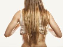 Femme avec de longs cheveux de Brown blanc d'isolement de vue arrière Photographie stock libre de droits