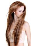 Femme avec de longs poils droits de beauté Photographie stock