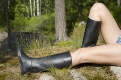 Femme avec de longues pattes Photographie stock