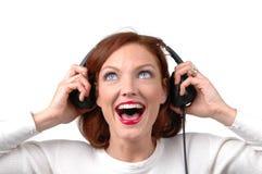 Femme avec des écouteurs images libres de droits