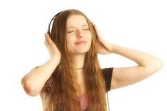 Femme avec des écouteurs Photo libre de droits