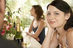 Femme avec des amis à la partie Image stock