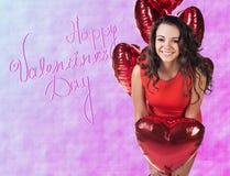 Femme avec des baloons de valentine Images stock