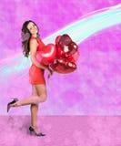 Femme avec des baloons de valentine Image stock