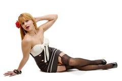 Femme avec des bas, se trouvant sur le plancher Photographie stock libre de droits