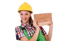 Femme avec des briques d'isolement Photographie stock libre de droits