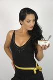 Femme avec des céréales Photographie stock libre de droits