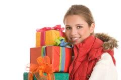 Femme avec des cadeaux Photographie stock libre de droits