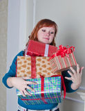 Femme avec des cadeaux Photos stock