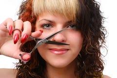 Femme avec des ciseaux Photos stock