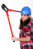 Femme avec des coupeurs de boulon Image libre de droits