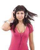 Femme avec des écouteurs Image libre de droits