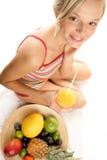 Femme avec des fruits Photographie stock